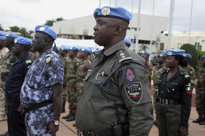 African soldiers and police who helped France take back control of Mali's north earlier this year participate in a ceremony formally transforming the force into a United Nations peacekeeping mission, in Bamako, Mali, Monday, July 1, 2013. The roughly 6,000 African troops will be folded into the Integrated United Nations Mission for the Stabilization of Mali, or MINUSMA, which is expected to grow to more than 12,000 soldiers. (AP Photo/Harouna Traore)