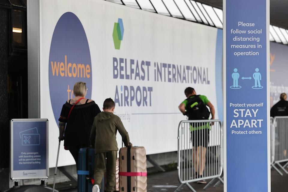 Travellers at Belfast International Airport (Liam McBurney/PA) (PA Archive)
