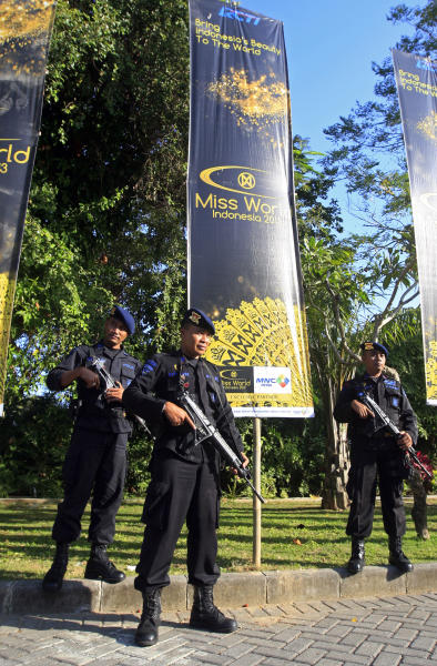 Indonesian police officers stand guard near the venue of the Miss World competition in Nusa Dua, Bali, Indonesia, Saturday, Sept. 28, 2013. The Miss World final will be held later in the day after weeks of protests from Muslim hardliners and warnings that extremists could attack the pageant. (AP Photo/Firdia Lisnawati)