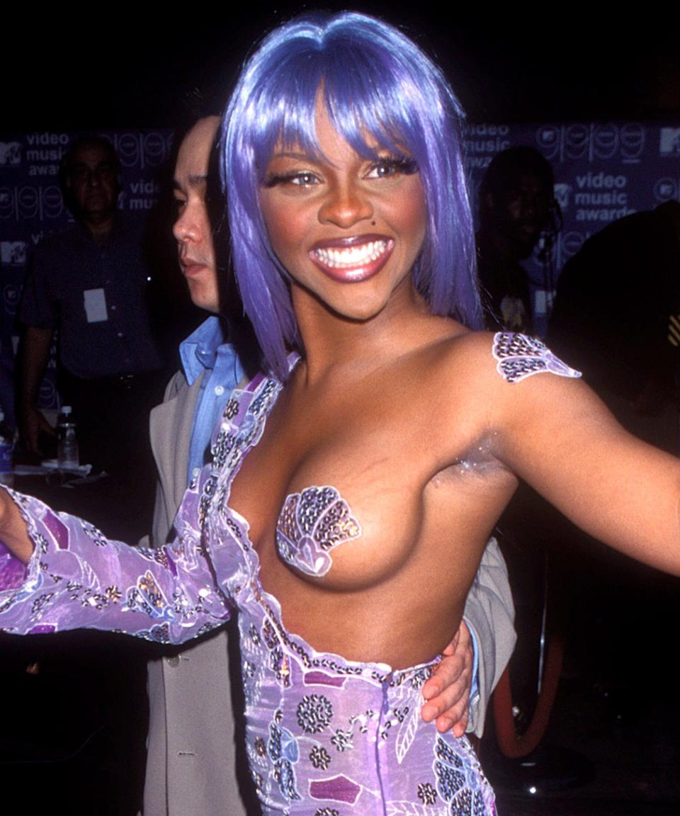 "<h3>Lil' Kim</h3><br>When Lil' Kim arrived at the 1999 VMAs wearing a bright purple wig and a matching seashell nipple cover, we knew the appearance would serve as costume inspiration for decades to come.<span class=""copyright"">Photo: Vinnie Zuffante/Getty Images.</span>"