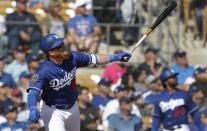 Los Angeles Dodgers' Justin Turner flies out to left during the fifth inning of a spring training baseball game against the Cleveland Indians, Thursday, March 1, 2018, in Glendale, Ariz. (AP Photo/Carlos Osorio)