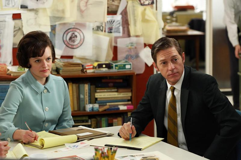 "This TV publicity image released by AMC shows Elisabeth Moss as Peggy Olson, left, and Kevin Rahm as Ted Chaough in a scene from ""Mad Men."" The season finale airs Sunday, June 23, on AMC. (AP Photo/AMC, Michael Yarish)"
