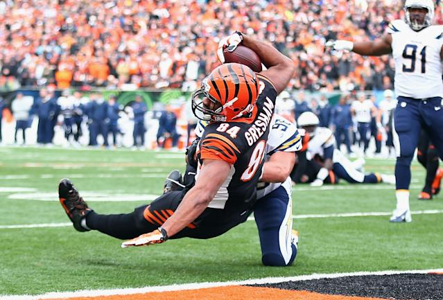 CINCINNATI, OH - JANUARY 05: Jermaine Gresham #84 of the Cincinnati Bengals catches a touchdown pass the NFL wild card playoffs game against the San Diego Chargers at Paul Brown Stadium on January 5, 2014 in Cincinnati, Ohio. (Photo by Andy Lyons/Getty Images)