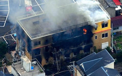 """The suspect was heard to shout """"Die"""" before using a lighter to start the fire - Credit: Asahi Shimbun"""