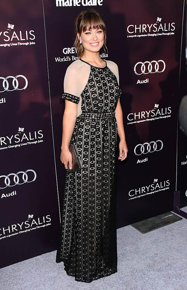 "Wow! Is it just me, or did Olivia Wilde kill it at the Chrysalis Butterfly Ball in this interesting Yigal Azrouel Resort 2012 gown? Massive diamond earrings and a pewter Ferragamo clutch made for the perfect accessories. Amanda Leddy/<a href=""http://www.splashnewsonline.com"" target=""new"">Splash News</a> - June 11, 2011"