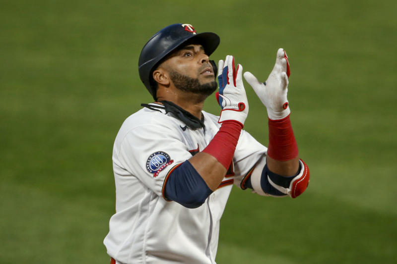 Minnesota Twins' Nelson Cruz celebrates his solo home run against the Kansas City Royals during the fourth inning of a baseball game Monday, Aug. 17, 2020, in Minneapolis. (AP Photo/Bruce Kluckhohn)