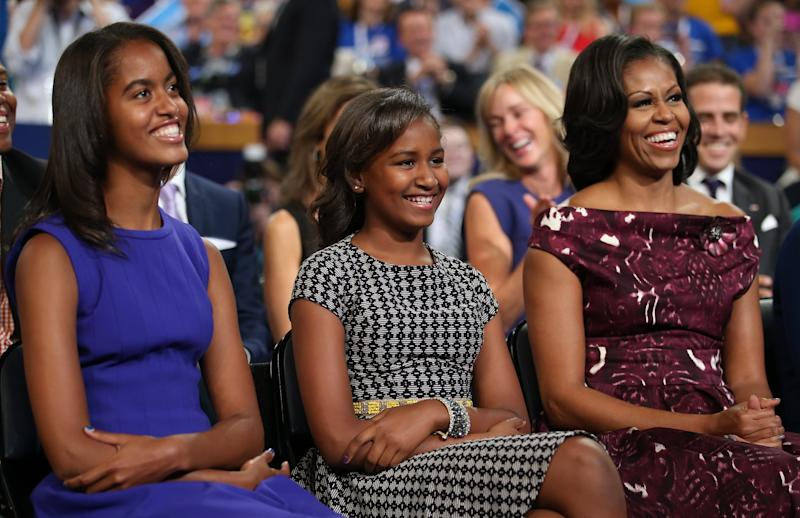 CHARLOTTE, NC - SEPTEMBER 06: (L-R) Malia Obama, Sasha Obama, and First lady Michelle Obama listen as Democratic presidential candidate, U.S. President Barack Obama speaks on stage during the final day of the Democratic National Convention at Time Warner Cable Arena on September 6, 2012 in Charlotte, North Carolina. The DNC, which concludes today, nominated U.S. President Barack Obama as the Democratic presidential candidate. (Photo by Chip Somodevilla/Getty Images)
