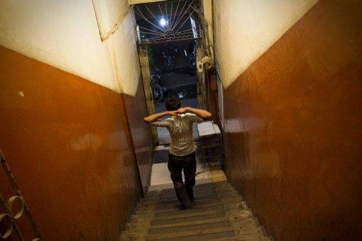 Pakistani sex worker, Nadeem who pimps 10 teenage sex workers aged 14-18, is seen walking down the stairs of a building in Karachi. According to charities which work to protect street children in Pakistan, up to 90 percent are sexually abused on the first night that they sleep rough and 60 percent accuse police of sexually abusing them