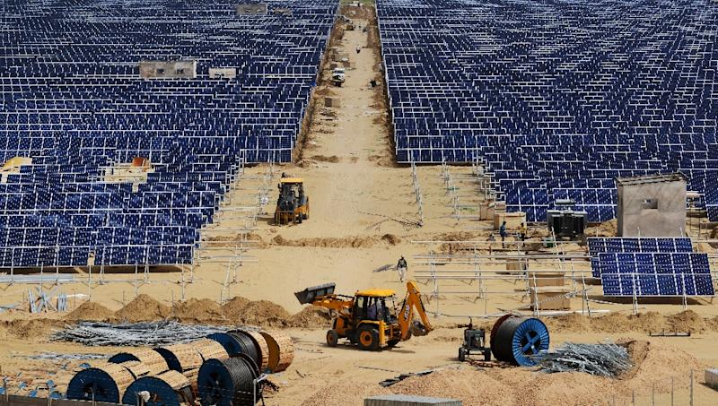 Construction takes place at Roha Dyechem solar plant in Bhadla, some 225 km north of Jodhpur, in the western Indian state of Rajasthan (AFP Photo/Money Sharma)