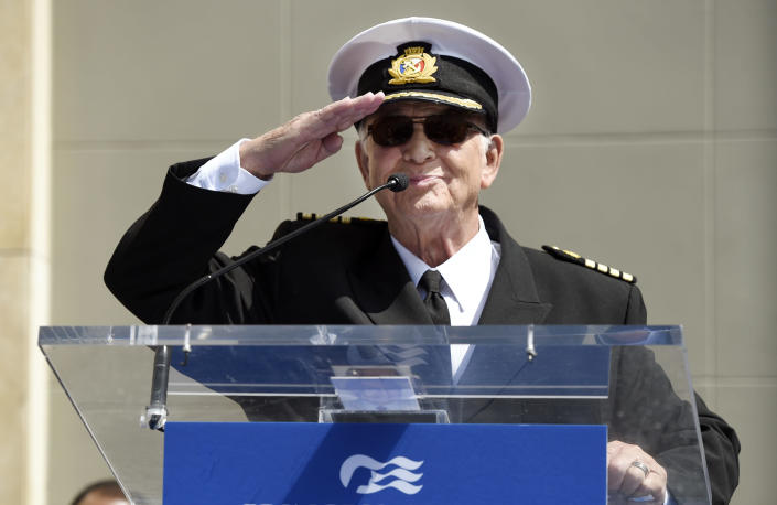 """FILE - In this May 10, 2018 file photo, Gavin MacLeod, a cast member on the TV series """"The Love Boat,"""" salutes the crowd as he speaks at a Friends of Hollywood Walk of Fame honorary star plaque ceremony for the cast and Princess Cruises in Los Angeles. Gavin MacLeod has died. His nephew told the trade paper Variety that MacLeod died early Saturday, May 29, 2021. (Photo by Chris Pizzello/Invision/AP, File)"""