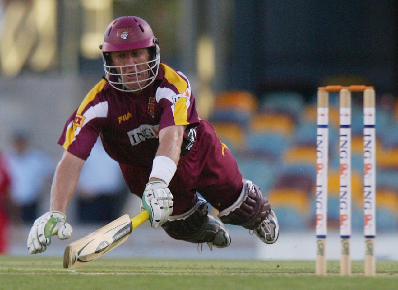 BRISBANE, AUSTRALIA - DECEMBER 17:  Clinton Perren of the Bulls dives for the crease to avoid a runout during the ING Cup match between the QLD Bulls and the Southern Redbacks played at the Gabba December 17, 2003 in Brisbane, Australia.  (Photo by Jonathan Wood/Getty Images)