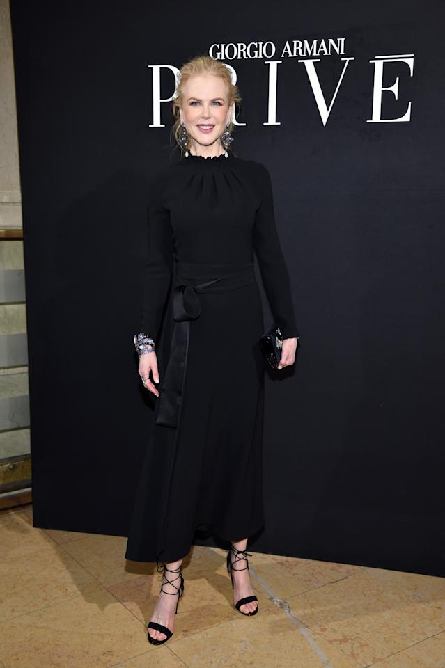 <p>Nicole was completely chic in a fitted black gown and tie-up sandals. <i>[Photo: Getty]</i> </p>