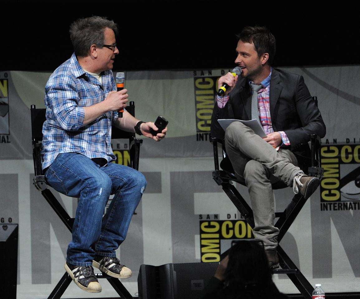"SAN DIEGO, CA - JULY 12:  Director Rich Moore (L) and Chris Hardwick speak at the ""Wreck-It Ralph"" panel during Comic-Con International 2012 at San Diego Convention Center on July 12, 2012 in San Diego, California.  (Photo by Kevin Winter/Getty Images)"