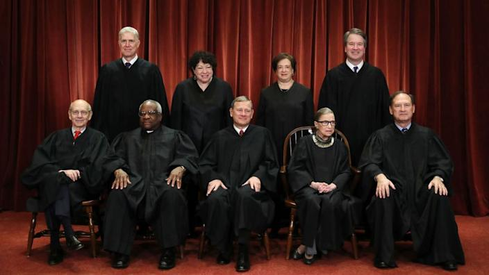 The US Supreme Court justices pose for their official portrait in November 2018