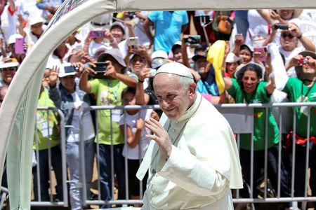 Pope Francis waves as he arrives at the Basadre Institute in Puerto Maldonado