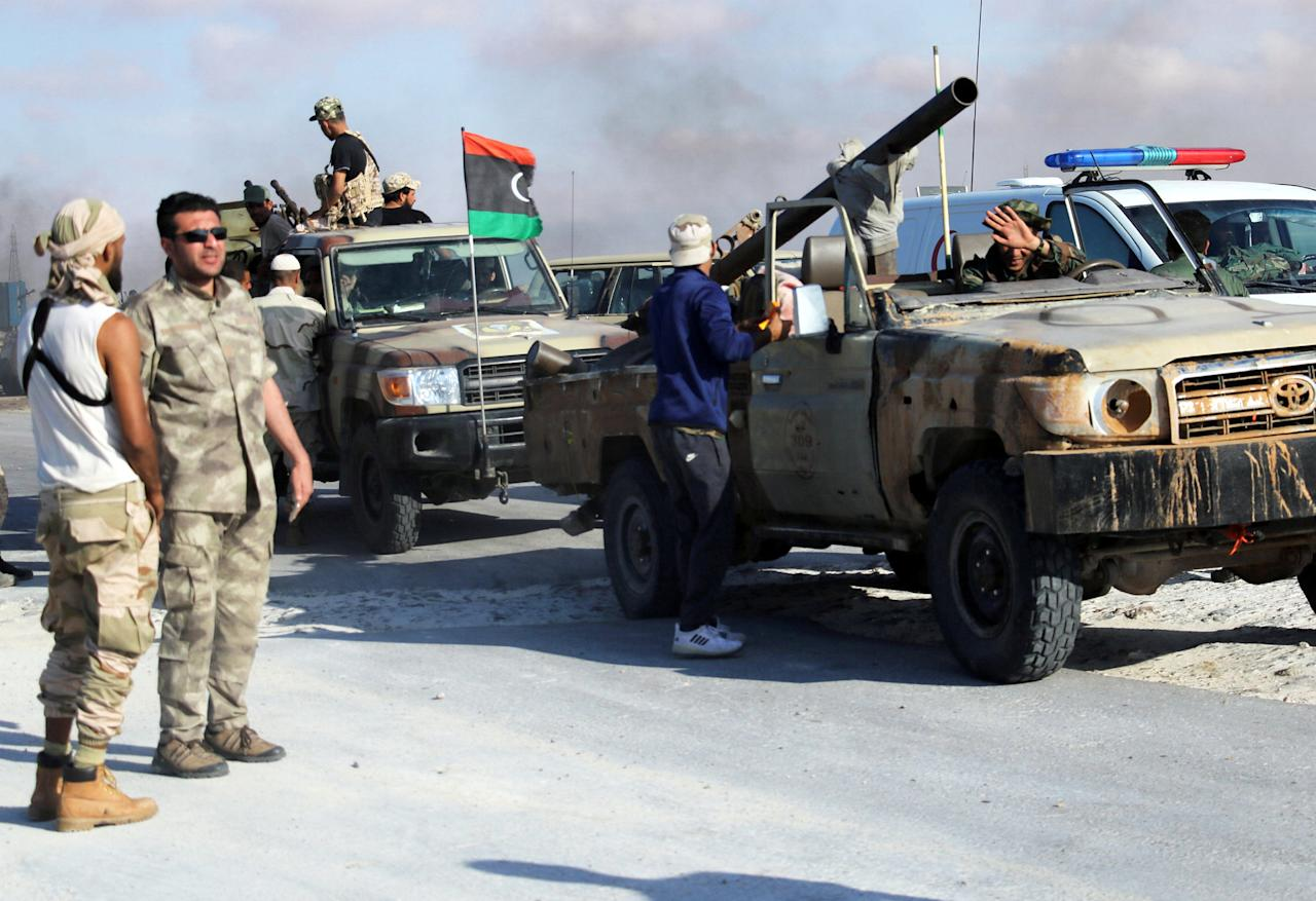 Members of the Libyan National Army are seen next to Sidra oil port in Ras Lanuf, Libya June 21, 2018. Picture taken June 21, 2018. REUTERS/Stringer .  NO RESALES. NO ARCHIVE.