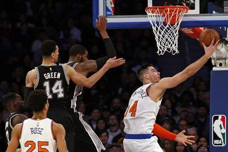 Feb 12, 2017; New York, NY, USA; New York Knicks center Willy Hernangomez (14) drives to the basket past San Antonio Spurs guard Danny Green (14) during the second half at Madison Square Garden. Mandatory Credit: Adam Hunger-USA TODAY Sports