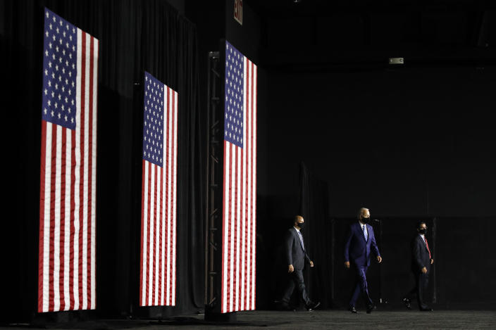 Democratic presidential candidate, former Vice President Joe Biden, second from right, arrives to speak at a campaign event, Tuesday, July 14, 2020, in Wilmington, Del. (AP Photo/Patrick Semansky)