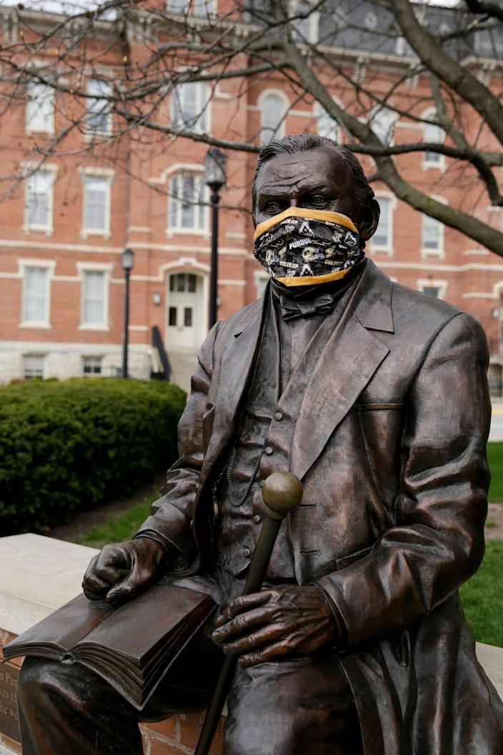 A statue of John Purdue, the founder of Purdue University, was wearing a mask on April 7 in West Lafayette, Indiana.