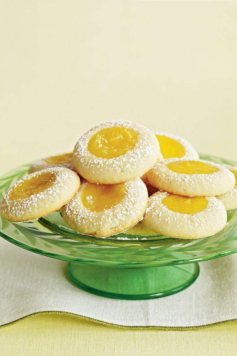 "<p>If mom loves all things lemon, she won't be able to keep her hands off these bite-sized treats, which are filled with lemon curd and lightly dusted with sugar.</p><p><strong><a href=""https://www.countryliving.com/food-drinks/recipes/a31919/lemon-dimples-recipe-122290/"" rel=""nofollow noopener"" target=""_blank"" data-ylk=""slk:Get the recipe"" class=""link rapid-noclick-resp"">Get the recipe</a>.</strong></p>"