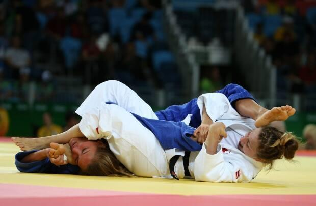 Canadian judoka Catherine Beauchemin-Pinard, featured right in this file photo from 2016, won a bronze medal in the under-63-kilogram classification at the Antalya judo Grand Slam event on Friday.  (Toru Hanai/Reuters - image credit)