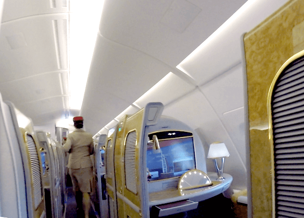 <p>I was greeted and escorted to my seat by a flight attendant. She asked if it was my first time in the Suites. In my most nonchalant voice, I answered that it was indeed my first time. She gave me a quick overview and immediately offered me a glass of champagne. <i>(Photo: Sam Huang)</i><br></p>