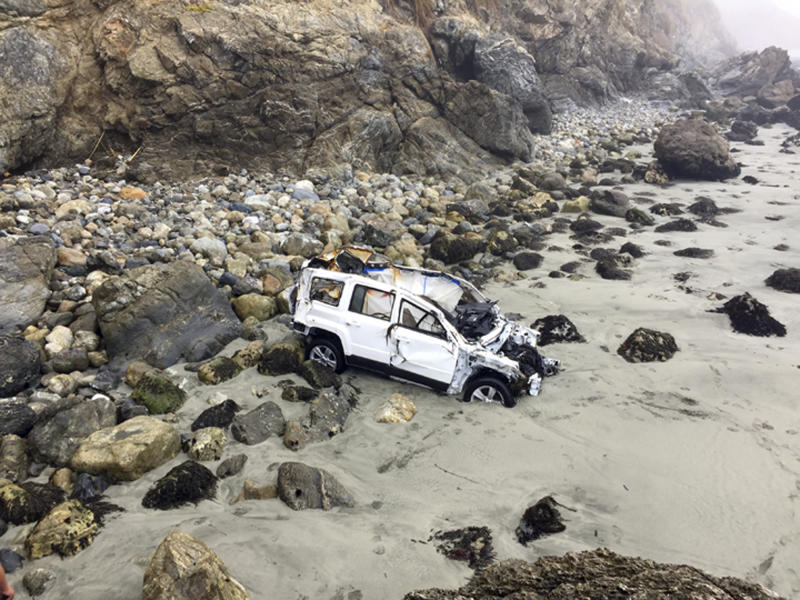 This Friday, July 13, 2018, photo shows the wrecked Jeep belonging to 23-year-old Angela Hernandez of Portland, Ore., after she survived a 250-foot car plunge off a cliff and a week stranded on a remote beach near Big Sur, Calif. (Chelsea Moore via AP)
