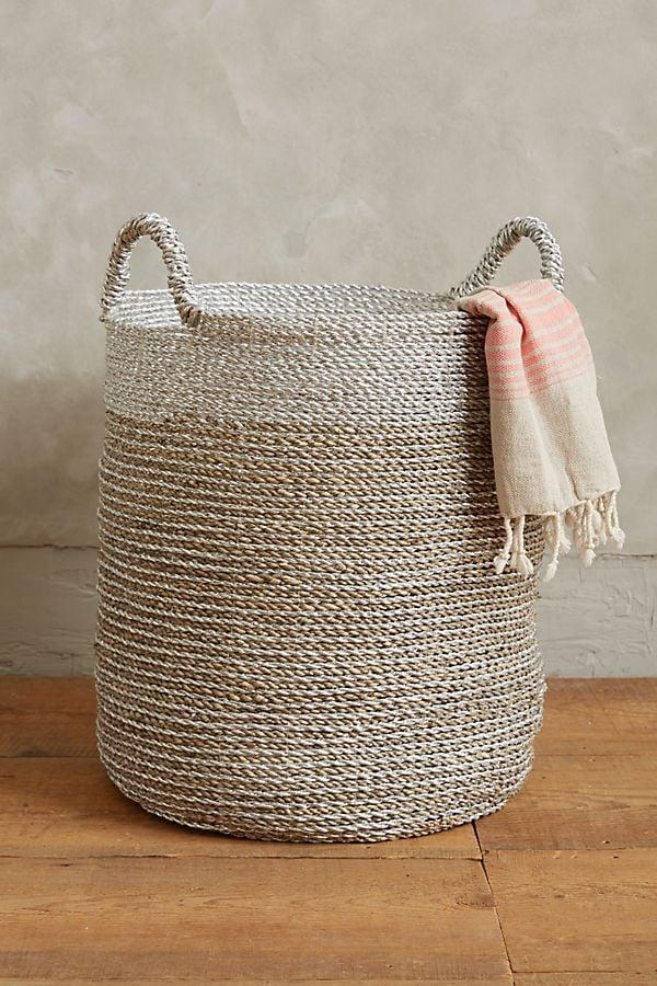 "<p>Replace that old laundry basket with this stylish <a href=""https://www.popsugar.com/buy/Sun-Stream-Basket-548035?p_name=Sun%20Stream%20Basket&retailer=anthropologie.com&pid=548035&price=108&evar1=casa%3Aus&evar9=47203882&evar98=https%3A%2F%2Fwww.popsugar.com%2Fhome%2Fphoto-gallery%2F47203882%2Fimage%2F47204444%2FSun-Stream-Basket&list1=shopping%2Corganization%2Csmall%20space%20living%2Cbathrooms%2Chome%20organization%2Chome%20shopping&prop13=mobile&pdata=1"" class=""link rapid-noclick-resp"" rel=""nofollow noopener"" target=""_blank"" data-ylk=""slk:Sun Stream Basket"">Sun Stream Basket</a> ($108).</p>"