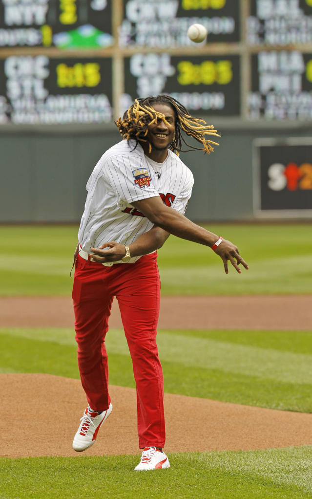 Minnesota Vikings wide receiver Cordarelle Patterson throws out the ceremonial pitch before a Minnesota Twins baseball game against the Kansas City Royals in Minneapolis, Saturday, April 12, 2014. (AP Photo/Ann Heisenfelt)