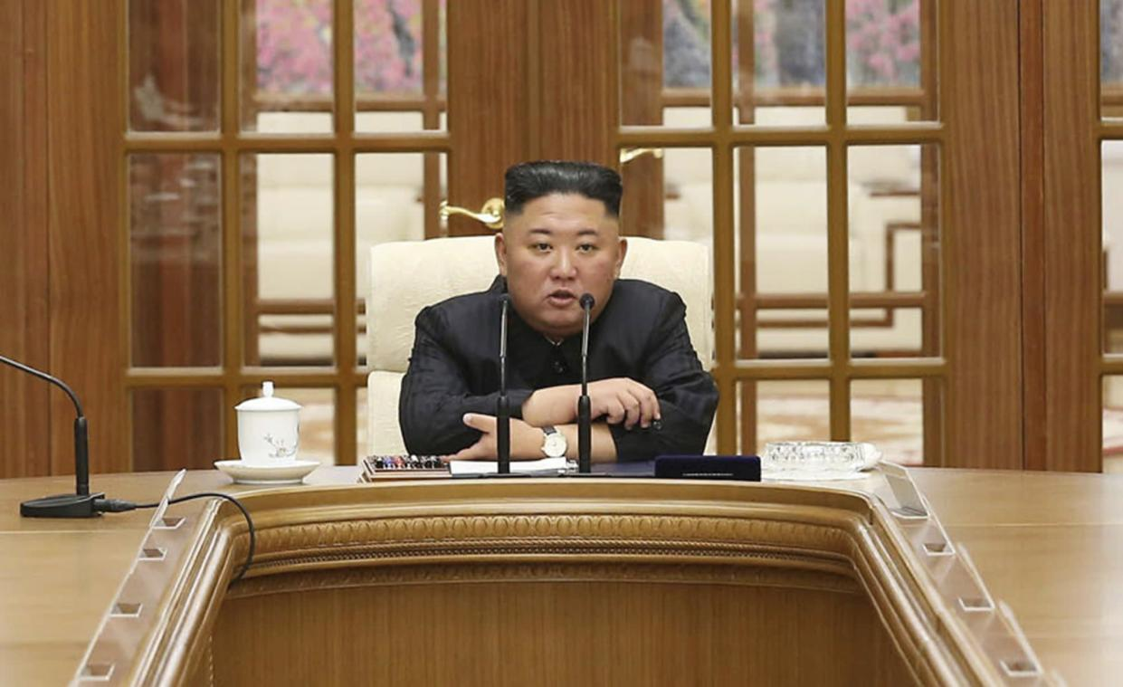 In this photo provided by the North Korean government, Kim Jong Un attends a meeting in Pyongyang, North Korea, on Friday.