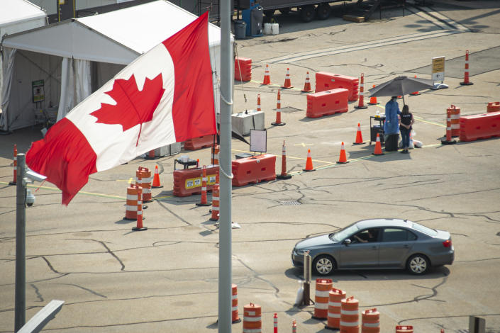 FILE - A car crosses the border into Canada, in Niagara Falls, Ontario, on Aug. 9, 2021. American citizens and permanent residents are now allowed to enter Canada for non-essential purposes if they can provide proof that they've been fully vaccinated for at least 14 days. (Eduardo Lima/The Canadian Press via AP, File)