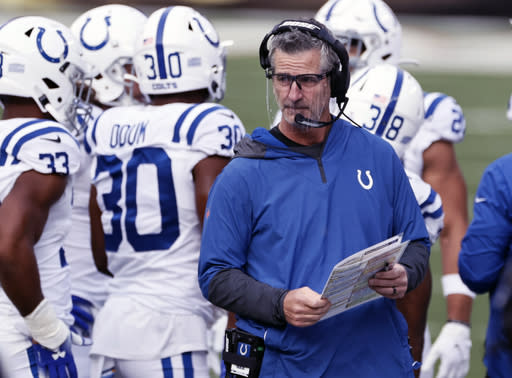 FILE - Indianapolis Colts head coach Frank Reich stands on the sideline during the first half of an NFL football game against the Cleveland Browns in Cleveland, in this Sunday, Oct. 11, 2020, file photo. Reich, a former quarterback for the Buffalo Bills, returns to Orchard Park, N.Y. for an NFL wild-card football game against the Bills on Saturday, Jan. 9, 2021.(AP Photo/Ron Schwane, File)