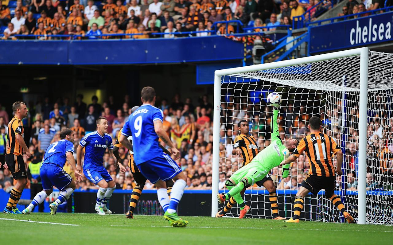 LONDON, ENGLAND - AUGUST 18: Goalkeeper Allan McGregor of Hull City makes a save as Branislav Ivanovic and John Terry of Chelsea look on during the Barclays Premier League match between Chelsea and Hull City at Stamford Bridge on August 18, 2013 in London, England. (Photo by Richard Heathcote/Getty Images)