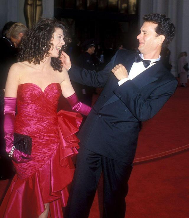 <p>Check out that dress! Rita, in one of her frilly trademark '80s dresses, accompanied her new husband at his <a href=