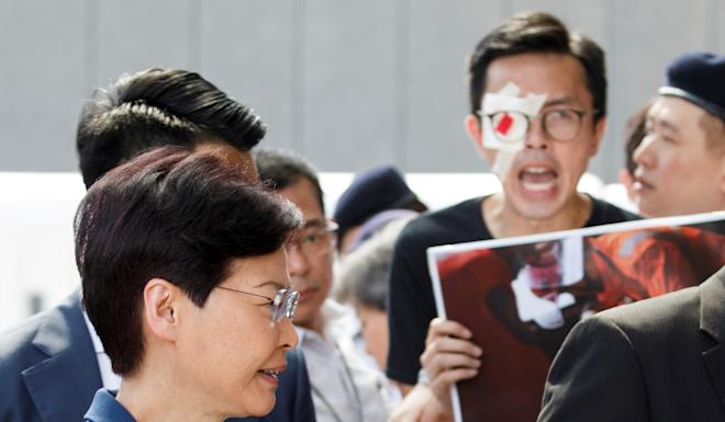 Hong Kong Chief Executive Carrie Lam meets petitioners outside her office on Tuesday. Photo: Reuters