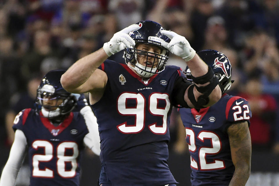 FILE - Houston Texans defensive end J.J. Watt (99) celebrates during the second half of an NFL wild-card playoff football game against the Buffalo Bills in Houston, in this Saturday, Jan. 4, 2020, file photo. J.J. Watt has agreed to a two-year contract with the Arizona Cardinals. The team announced the deal with the free-agent edge rusher on Monday, March 1, 2021. Watt was released last month by the Houston Texans. (AP Photo/Eric Christian Smith, File)