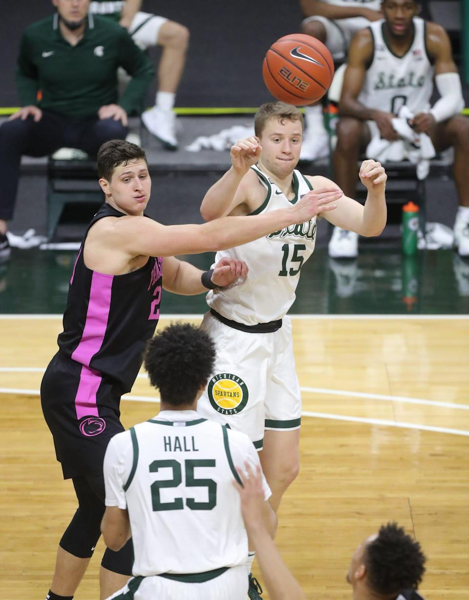 Michigan State Spartans forward Thomas Kithier passes against Penn State Nittany Lions forward John Harrar during the second half at Breslin Center, Tuesday, Feb. 9, 2021.