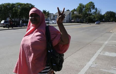 Local resident Shadia Abdi gestures before speaking to the media about her concerns on the impact of the Ebola crisis on African communities in Dallas, Texas, October 4, 2014. REUTERS/Jim Young