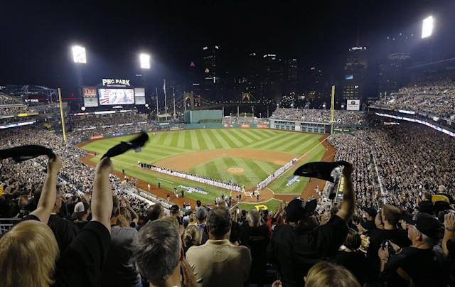 Fans wave towels at the finish of the national anthem before the NL wild-card playoff baseball game between the Pittsburgh Pirates and the Cincinnati Reds on Tuesday, Oct. 1, 2013, in Pittsburgh. (AP Photo/Keith Srakocic)