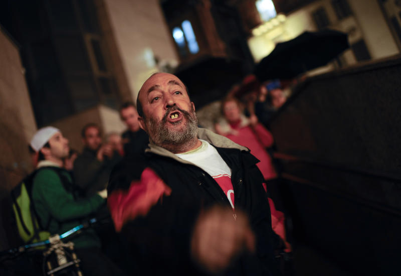 A man shouts slogans against evictions during a protest march in Barakaldo, northern Spain, Friday, Nov. 9, 2012. Officials say a woman fell to her death as bailiffs approached to evict her for non-payment of the mortgage from her fourth-floor apartment in a suburb of the northern Spanish city of Bilbao. Amaia Egana, 53-year-old, who worked at a local bus depot, was married to a former town councilor and had a 21-year-old daughter, launched herself off her balcony Friday, the regional Interior Ministry said.(AP Photo/Alvaro Barrientos)