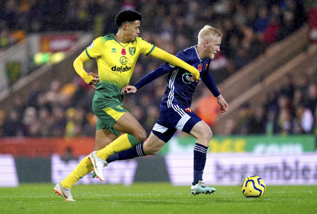 Norwich City's Jamal Lewis, left, and Watford's Will Hughes battle for the ball during the English Premier League soccer match at Carrow Road, Norwich, England, Friday Nov. 8, 2019. (John Walton/PA via AP)