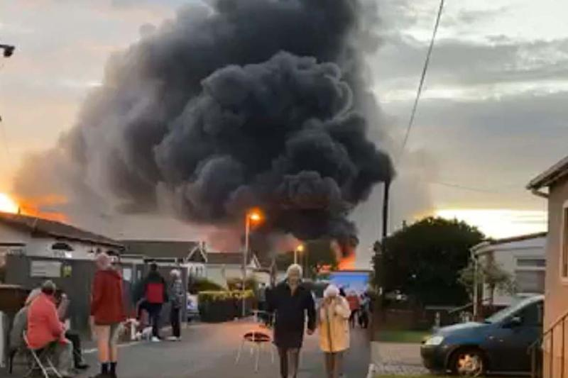 Firefighters continued to battle the blaze at an industrial building in Kent (PA)