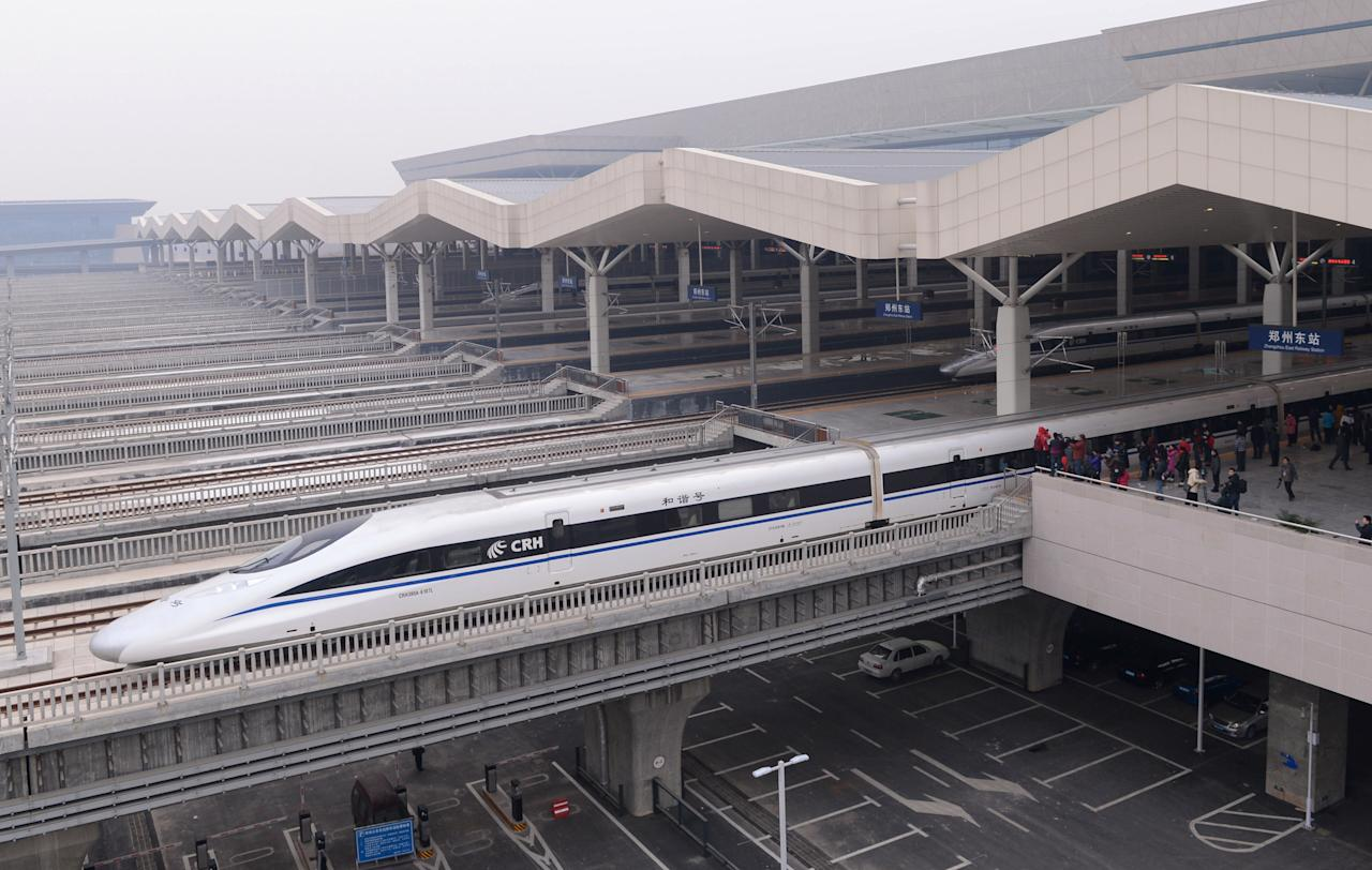 In this photo released by China's Xinhua news agency, a high-speed train G90 leaves for Beijing from the Zhengzhou East Railway Station in Zhengzhou, capital of central China's Henan Province, Wednesday, Dec. 26, 2012. China has opened the world's longest high-speed rail line, which runs 2,298 kilometers (1,428 miles) from the country's capital in the north to Guangzhou, an economic hub in the Pearl River delta in southern China. (AP Photo/Xinhu, Zhao Peng) NO SALES