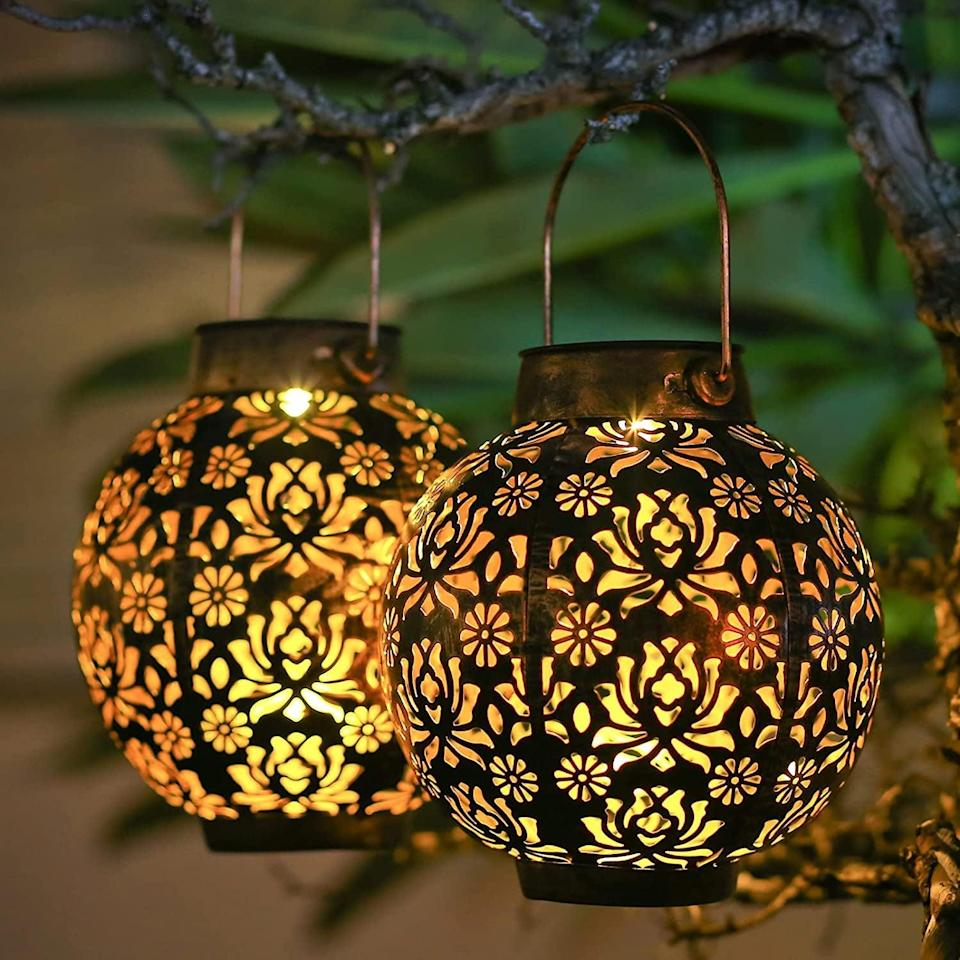 <p>Spruce up your backyard with these gorgeous and durable <span>Outdoor Waterproof Solar Lanterns</span> ($30). Hang them on trees or place them on tables, they'll automatically light up at night. No need to change out the batteries or plug them in.</p>