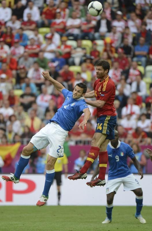 Italian defender Christian Maggio (L) fights for the ball with Spanish midfielder Xabi Alonso during the Euro 2012 championships football match Spain vs Italy on June 10, 2012 at the Gdansk Arena. AFP PHOTO / PIERRE-PHILIPPE MARCOUPIERRE-PHILIPPE MARCOU/AFP/GettyImages