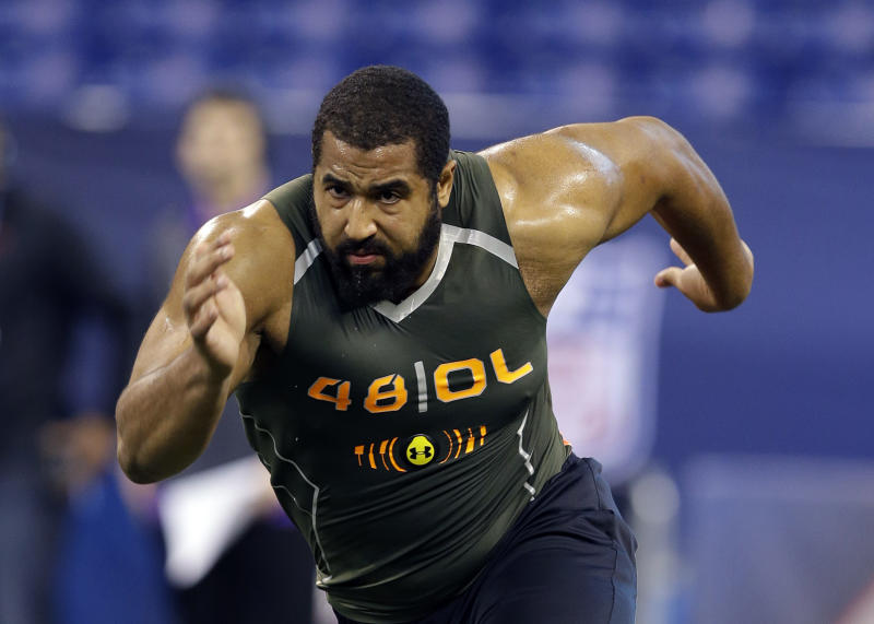 FILE - In this Feb. 22, 2014, file photo, Penn State offensive lineman John Urschel runs a drill at the NFL football scouting combine in Indianapolis. Urschel will routinely provide a look at his journey leading to the NFL draft on May 8 in a series of diary entries. (AP Photo/Michael Conroy, File)