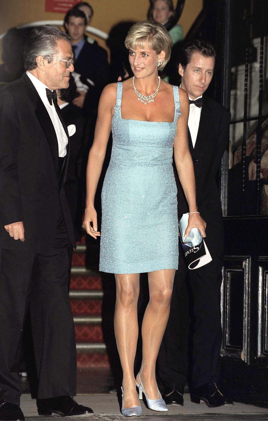 <p>Diana wore this memorable ice blue dress by Jacques Azagury to a performance of Swan Lake in London. </p>