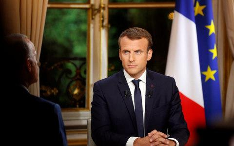 French President Emmanuel Macron is seen during his first long live television interview on prime time at the Elysee Palace in Paris, France, October 15 - Credit: PHILIPPE WOJAZER/Reuters
