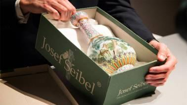 The vase was stashed in the attic for many years and was inherited by a French family who retrieved the vase and brought it to the auctioneer.