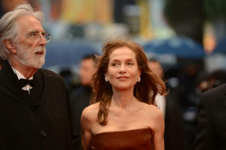"Austrian director Michael Haneke (L) and French actress Isabelle Huppert pictured at Cannes in 2012, when ""Amour"" was in competition"